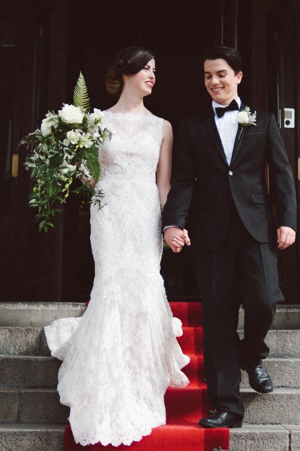 Bride and groom on steps of Duke of Cornwall Hotel