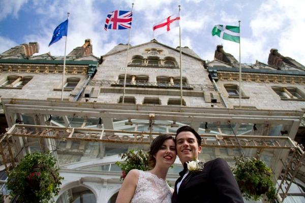 Bride and groom outside Duke of Cornwall Hotel