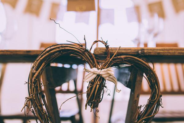 Twig heart on back of wedding chair