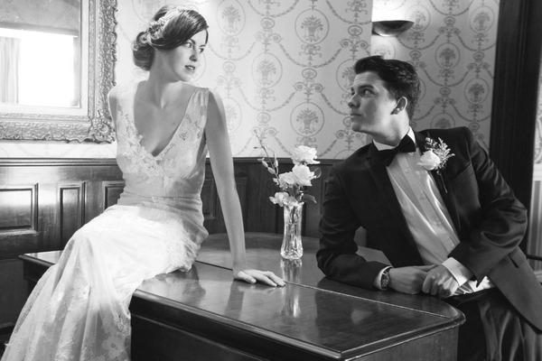 Retro bride and groom on piano