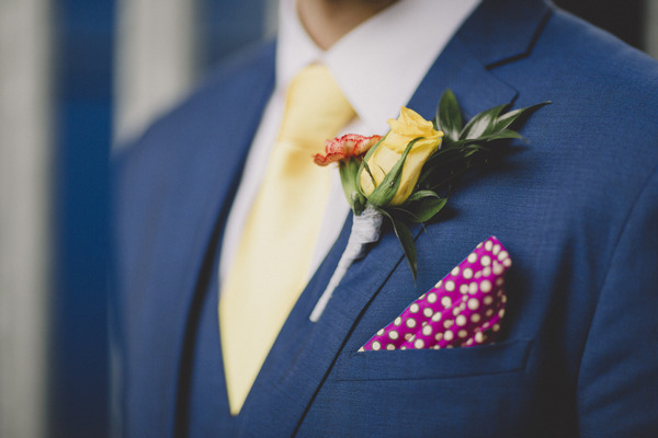 Groom's buttonhole and pink pocket handkerchief