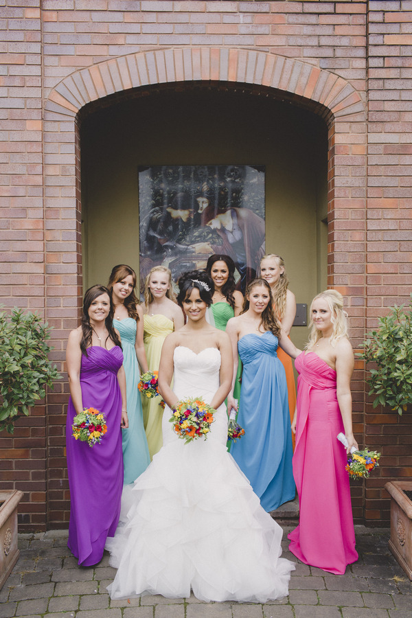 Bride with bridesmaids in colourful dresses