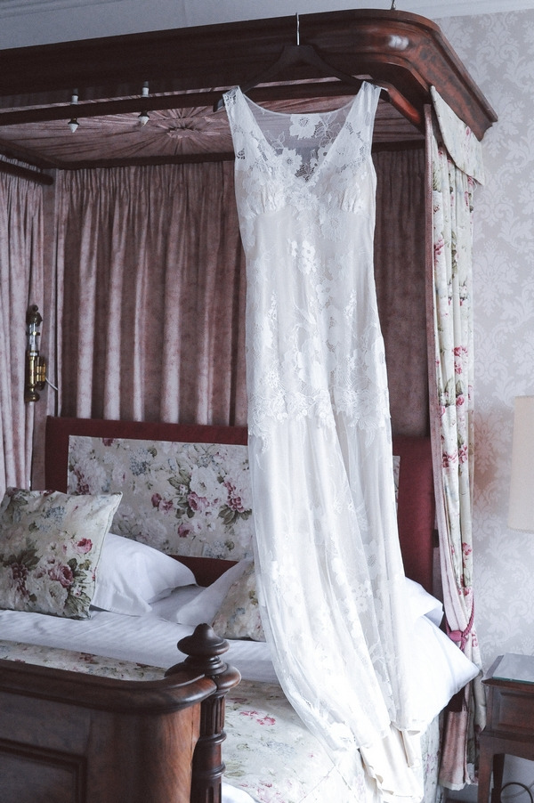Wedding dress hanging in bedroom at Duke of Cornwall Hotel