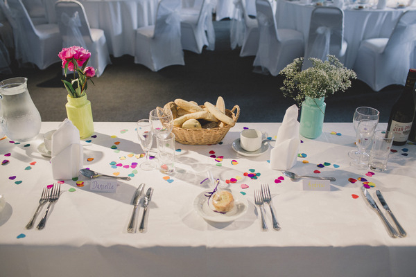 Wedding table with colourful confetti