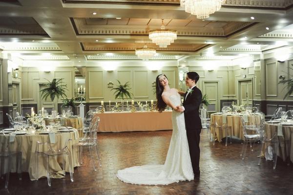Retro bride and groom dancing in ballroom at Duke of Cornwall Hotel