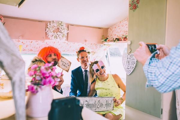 Wedding guests having picture taken with funny props