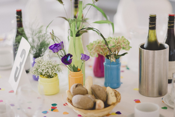 Small coloured vases of flowers