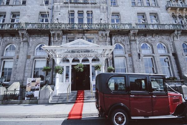 Vintage taxi outside Duke of Cornwall Hotel