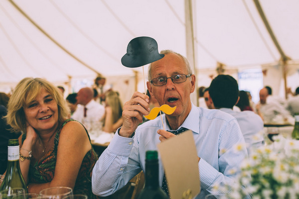 Wedding guest with prop hat and moustache