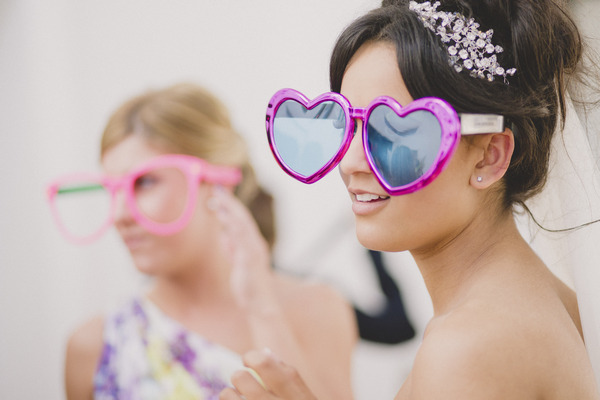 Bride with large heart sunglasses