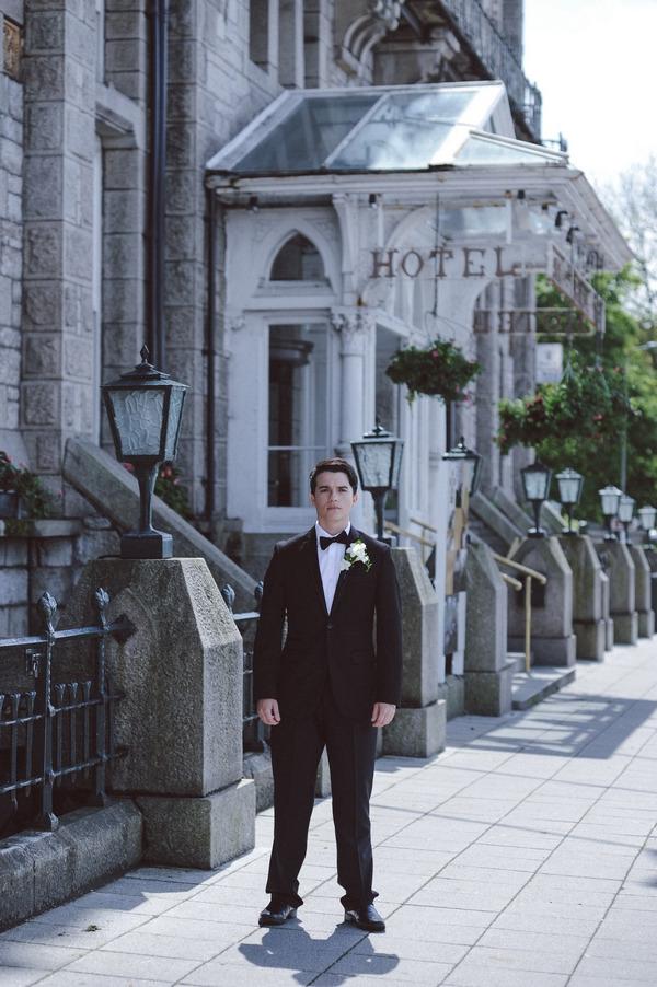 Retro groom outside Duke of Cornwall Hotel