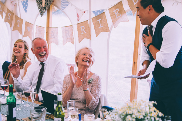 Wedding guest applauding best man speech