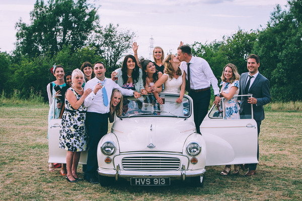 Lots of wedding guests in vintage Morris Minor