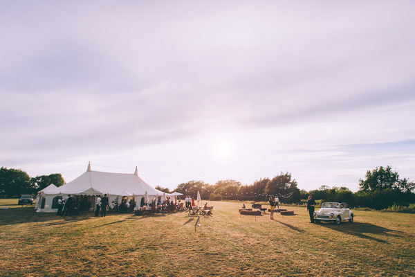 Marquee wedding in field by River Thames