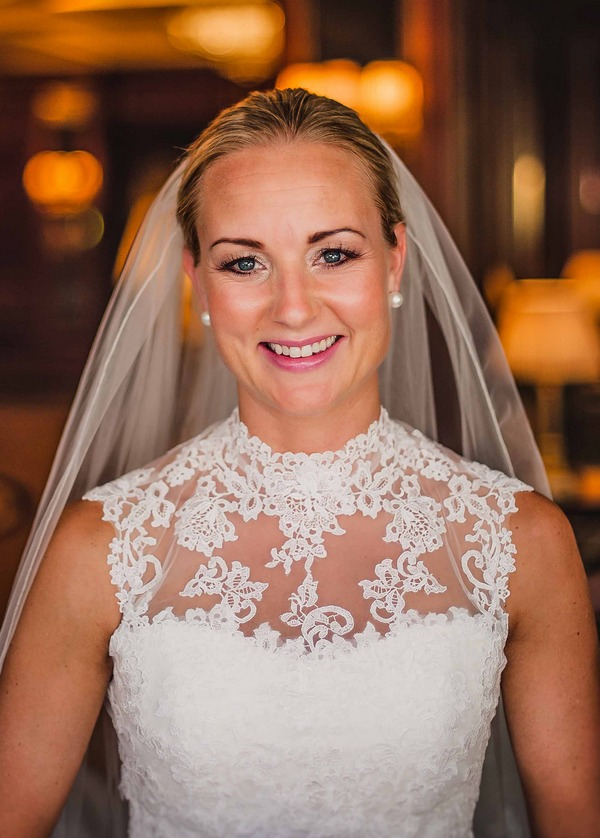 Bride with lace detail on top of wedding dress