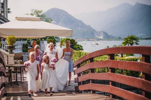 Bride and bridesmaids walking over bridge