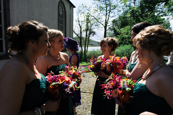Bridesmaids holding bright bouquets