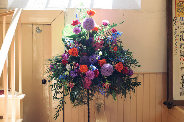 Bright wedding flowers in church