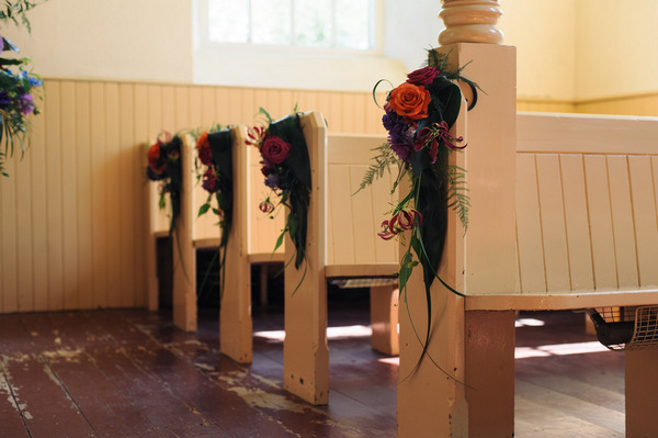 Bright pew end flowers