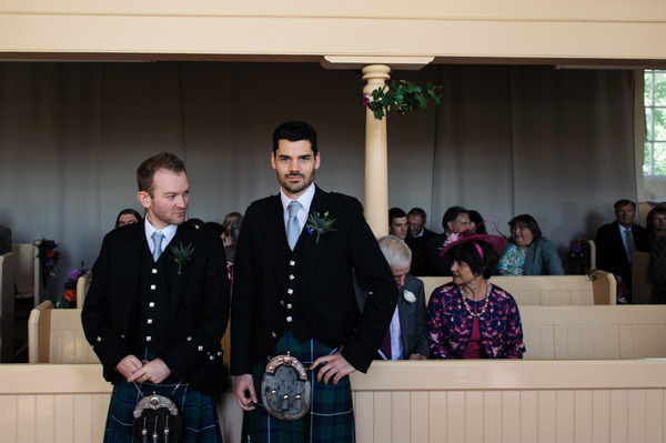 Groom in Scottish attire waiting at altar