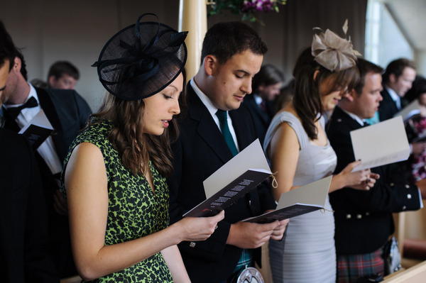 Wedding guests reading