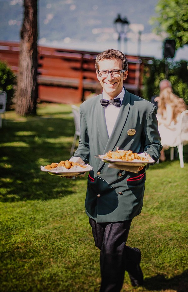 Man carrying plates of wedding food