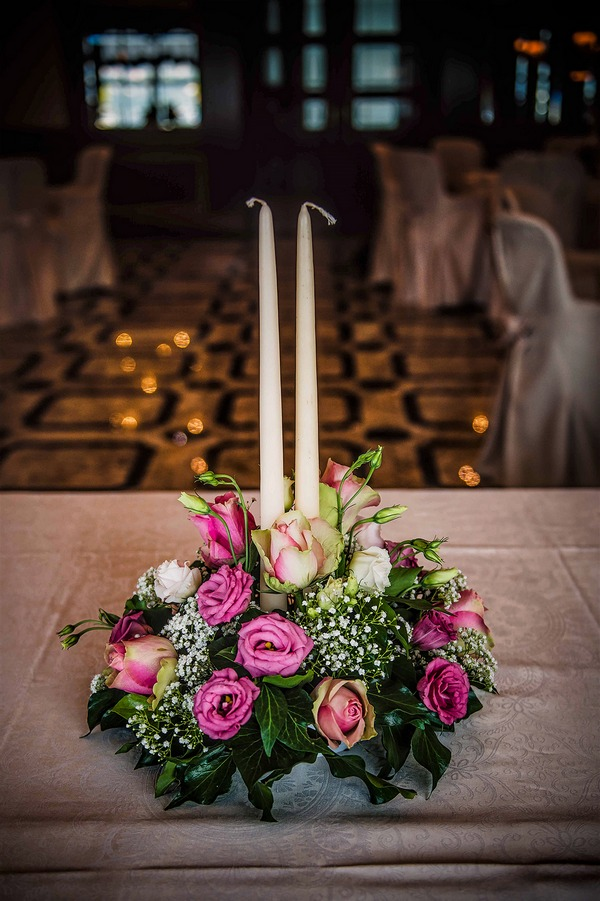 Tall candle wedding table centrepiece