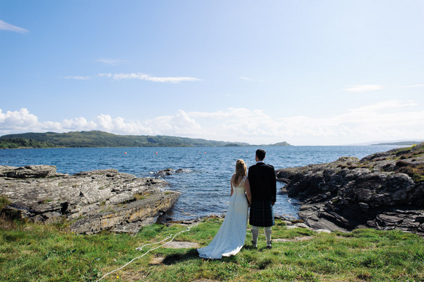 Bride and groom looking out over Loch Melfort