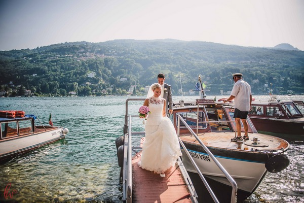 Bride and groom getting off boat