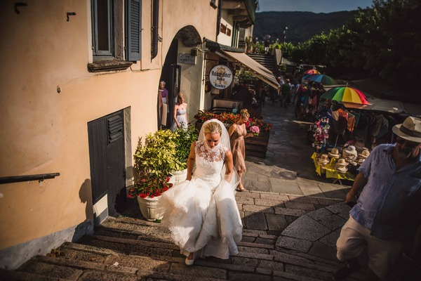 Bride walking up steps in Italy