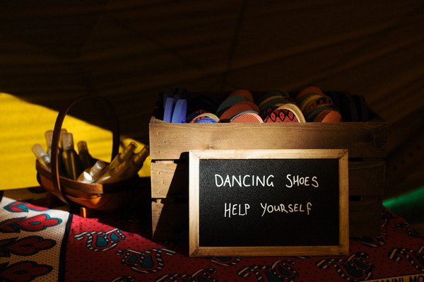 Box of dancing shoes at wedding