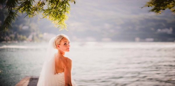 Bride standing by Lake Maggiore, Italy