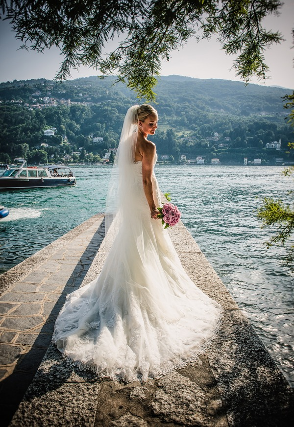 Bride holding bouquet by Lake Maggiore, Italy