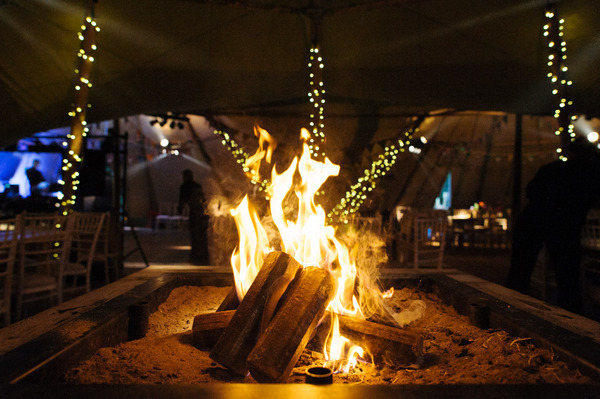 Log fire in wedding tipi