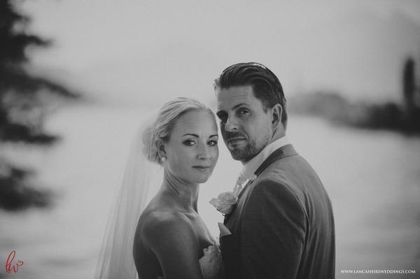 Bride and groom looking at camera