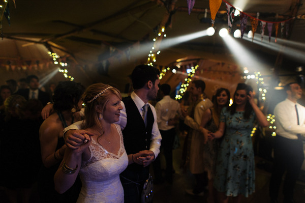 Bride and groom walk to dance floor