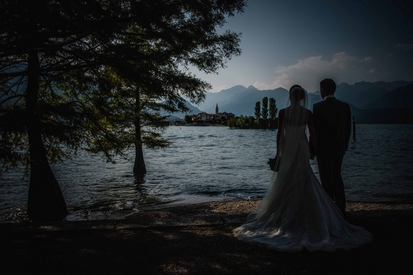 Bride and groom looking over Lake Maggiore, Italy