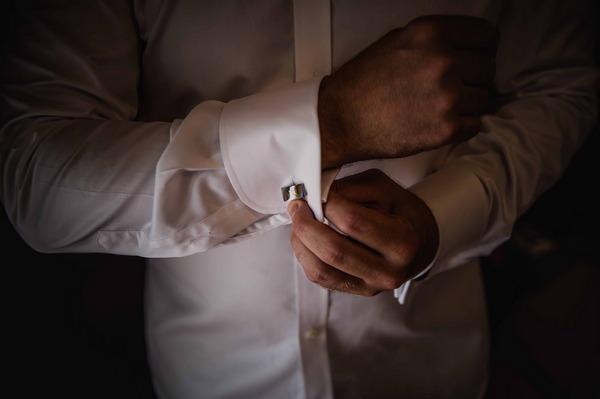 Groom fastening cufflink