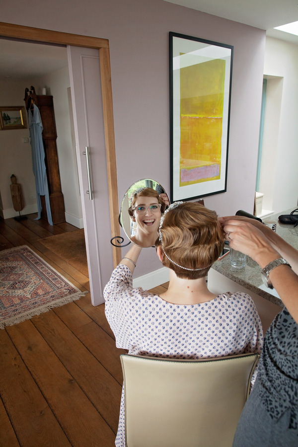 Reflection of bride's face in mirror