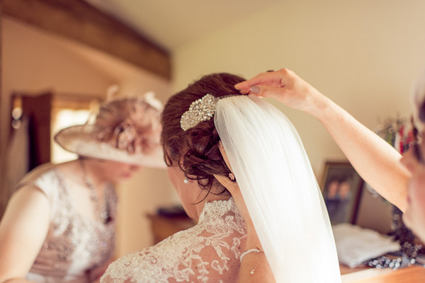 Putting on bride's veil