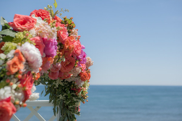 Colourful floral wedding ceremony arch