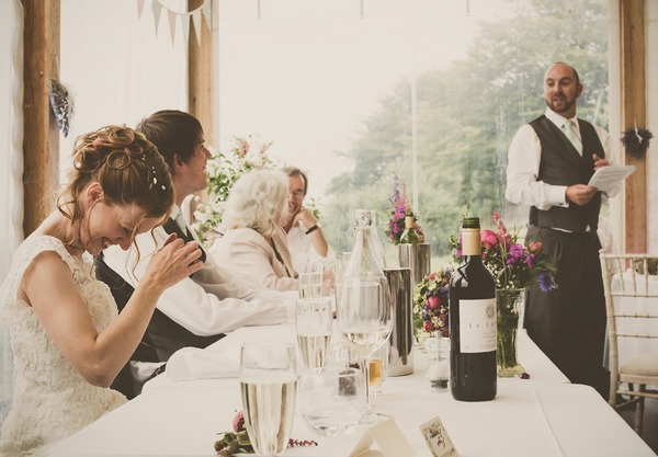Bride laughing at best man speech - Picture by Tracey Warbey Photography