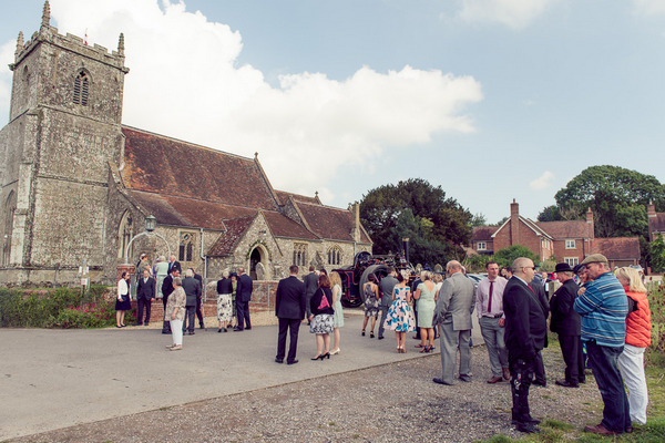 Wedding guests outside Stourpaine Holy Trinity Church in Dorset