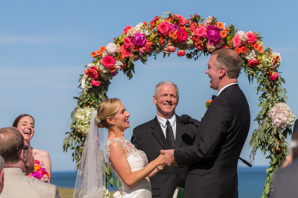 Bride and groom laughing during wedding ceremony on Nantucket Island