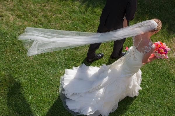 Bride's veil blowing in wind