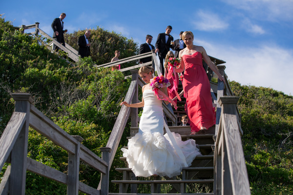 Bridal party walking down steps to beach on Nantucket Island