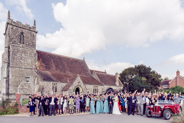 Wedding group shot outside Stourpaine Holy Trinity Church in Dorset