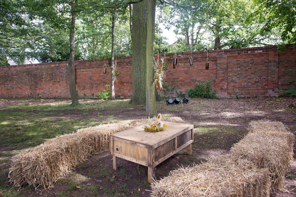 Rustic table and hay bales at wedding