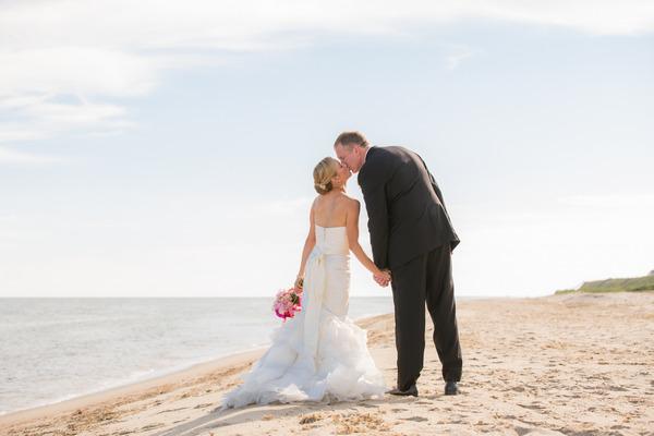 Bride and groom kiss on Nantucket Island beach