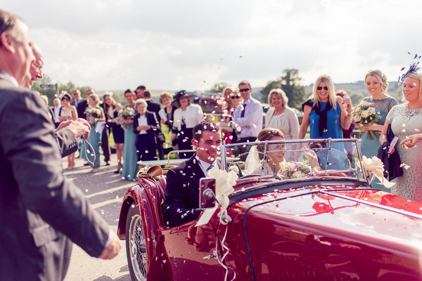 Bride and groom in vintage MG TC 1947 wedding car